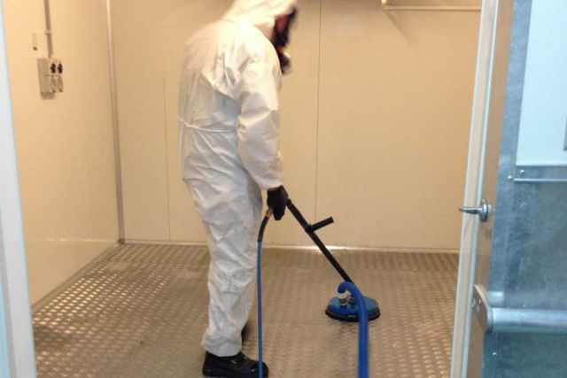 Pressure washing of walls and floor